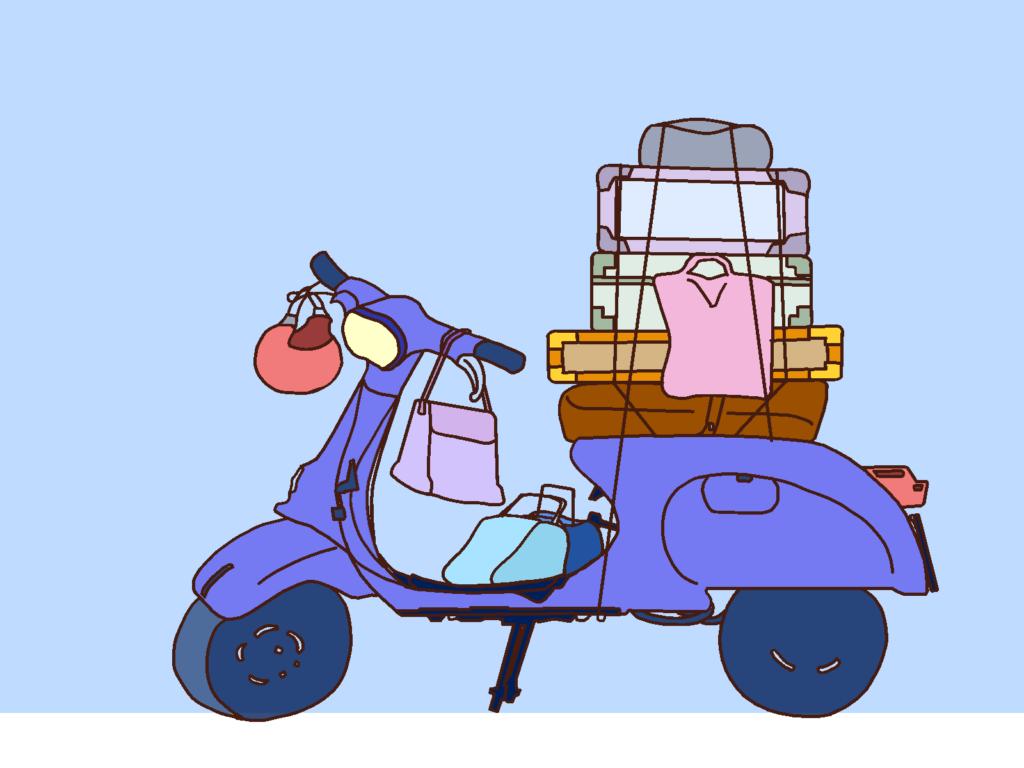 ベスパと荷物と青空。